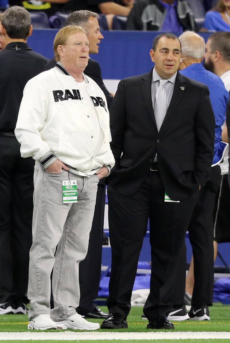 Raiders owner Mark Davis, left, speaks on the sideline with executive vice president and genera ...
