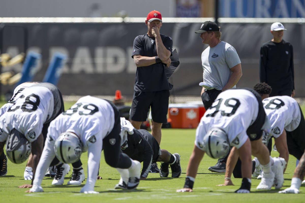 Raiders general manager Mike Mayock, left, and head coach Jon Gruden watch the team stretch dur ...