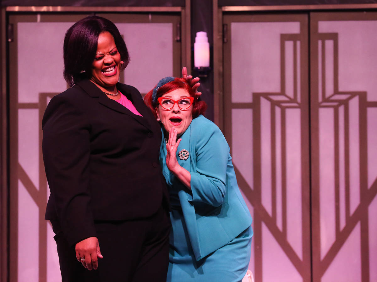 Lisa Mack performs as Professional Woman, left, and Cherity Harchis as Iowa Housewife, right, d ...