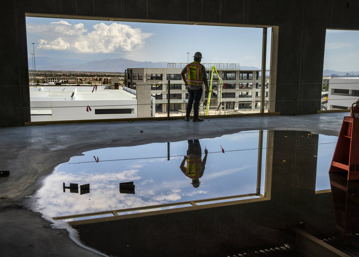 Reflection of the garage and Office Building #1 from Office Building #2 at UnCommons, a mixed-u ...