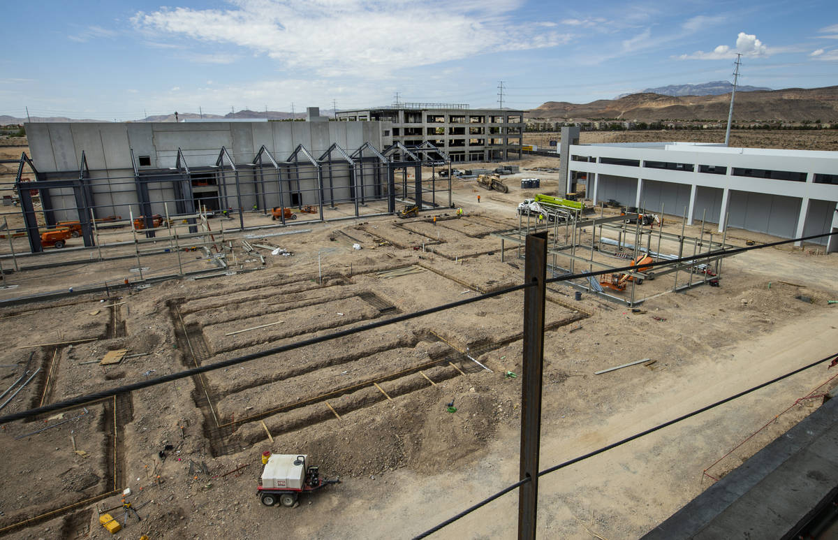 The Market Hall, top, other building foundations, center, and a garage take shape at UnCommons, ...