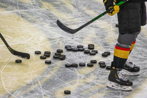 Pucks pile up on the ice as the Vegas Golden Knights warm up before the first period of their N ...