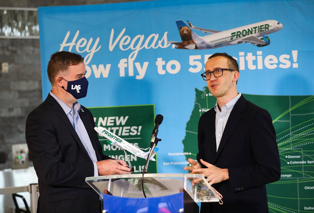 Chris Jones, chief marketing officer for McCarran International Airport, left, addresses the me ...