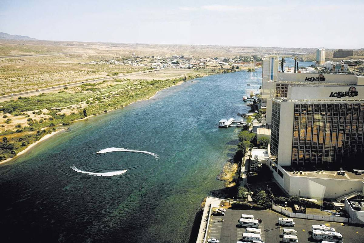 The Colorado River, the dividing line between the towns of Laughlin and Bullhead City, Ariz. (L ...