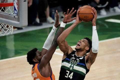 Milwaukee Bucks forward Giannis Antetokounmpo (34) shoots against Phoenix Suns center Deandre A ...