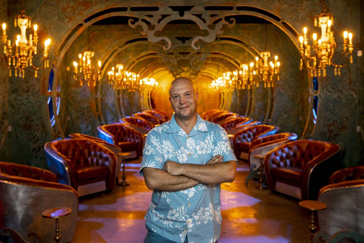 Bryan Davis, founder of Lost Spirits Distillery, poses for a portrait in a tasting room inspire ...