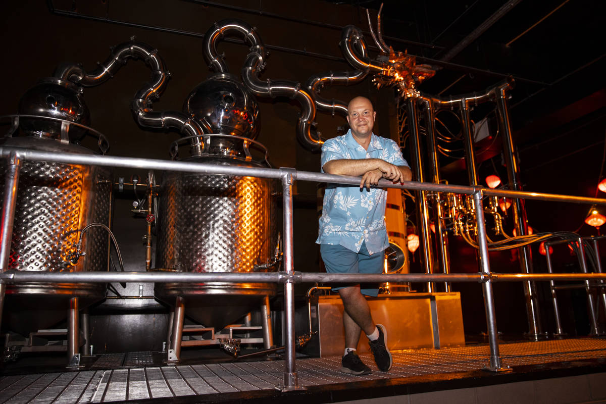 Bryan Davis, founder of Lost Spirits Distillery, poses for a portrait with his custom-built sti ...