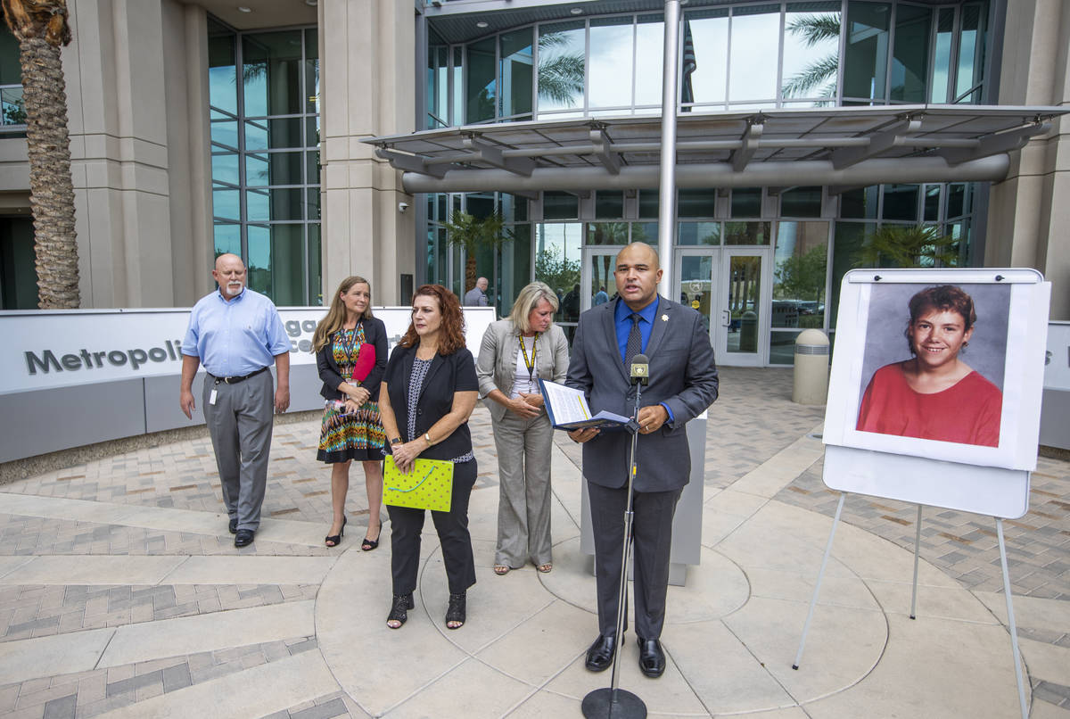 Homicide Lt. Ray Spencer, center, conducts a press conference beside a photo of Stephanie Ann I ...