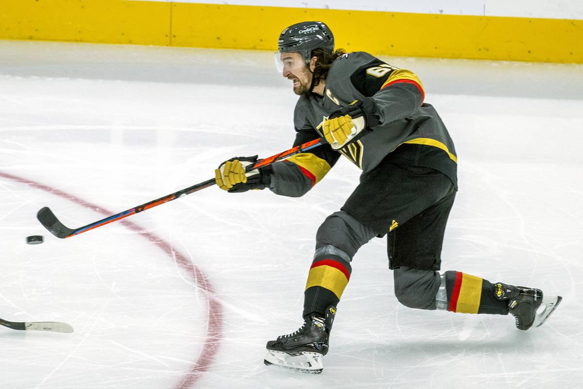 Golden Knights right wing Mark Stone (61) shoots on Minnesota Wild goaltender Cam Talbot (33) d ...