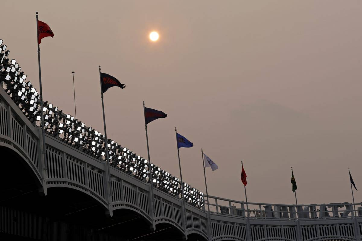 Smoke from Western wildfires dims the sun before the Philadelphia Phillies played New York Yank ...
