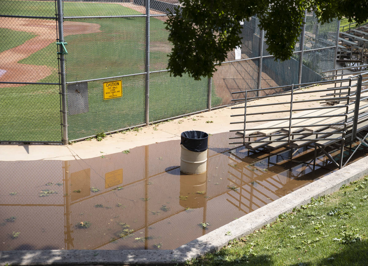 Baseball bleachers at Arroyo Grande Sports Complex are surrounded by flood water, on Friday, Ju ...