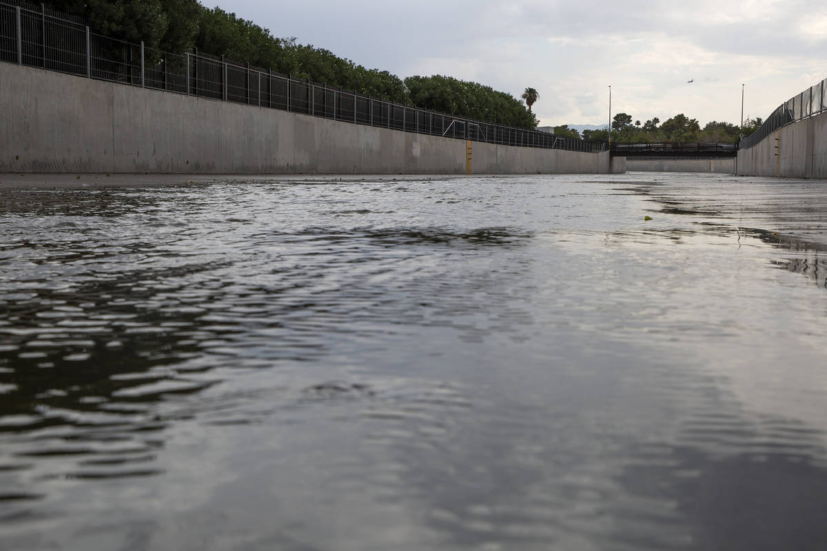 Flamingo Wash begins to fill from rain on Thursday, July 22, 2021, in Las Vegas. The National W ...