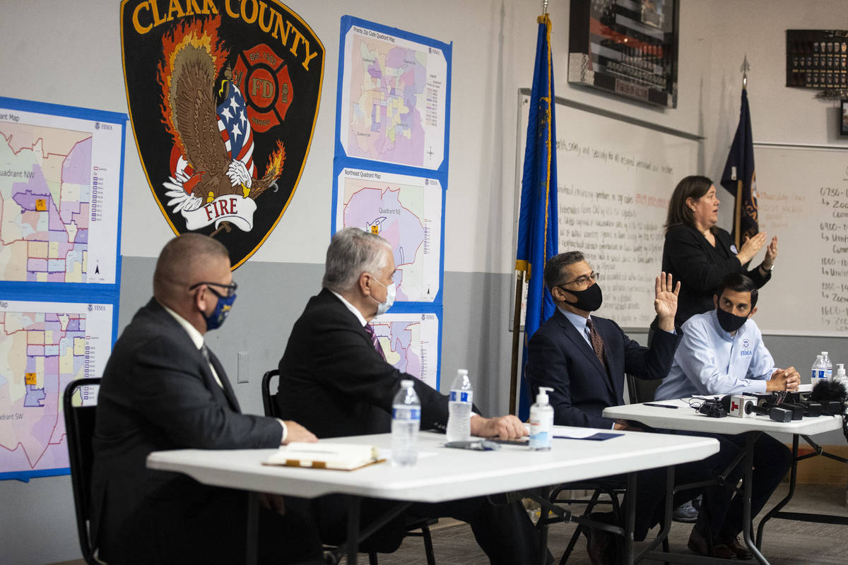 U.S. Health and Human Services Secretary Xavier Becerra, third from left, speaks during a brief ...
