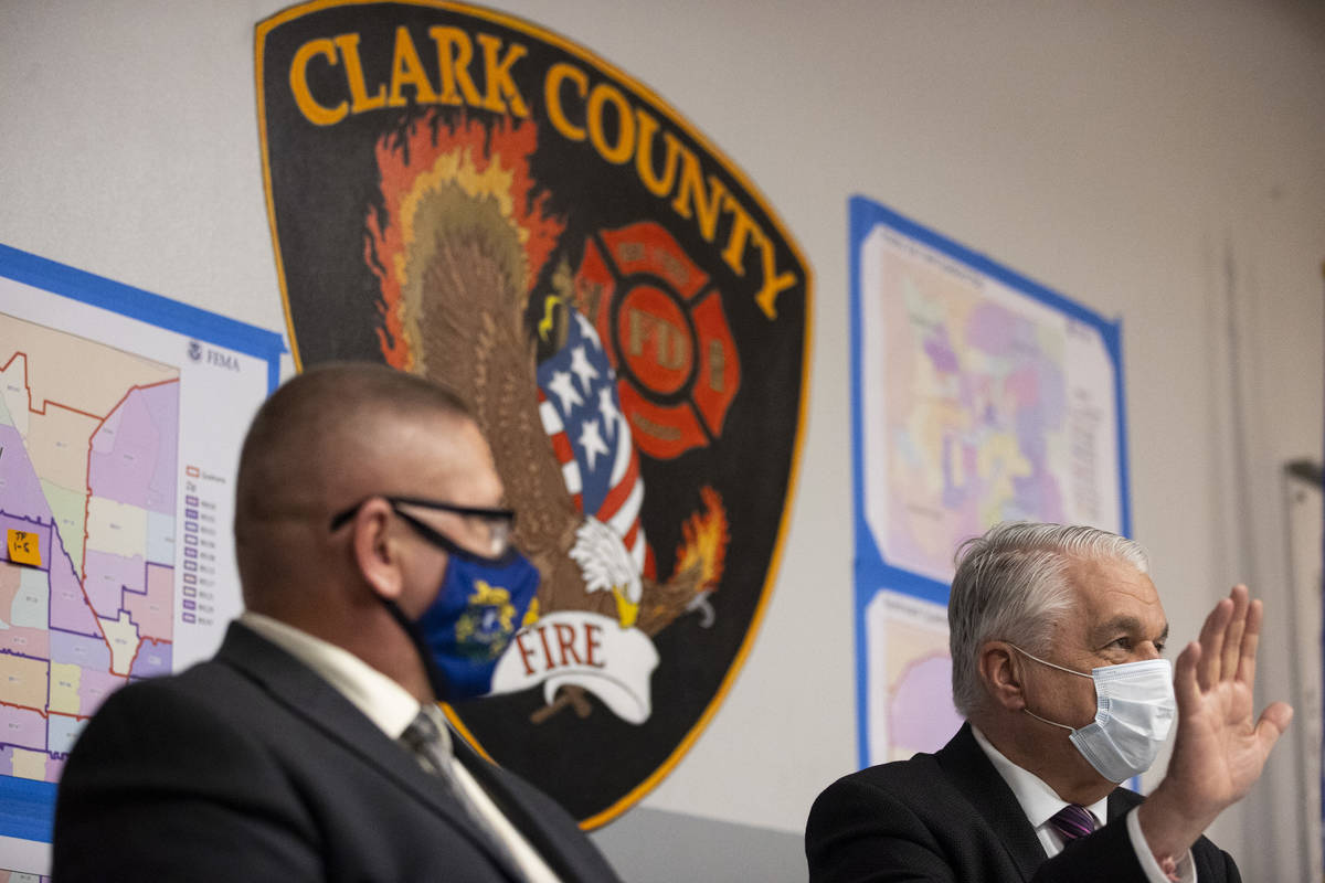 Nevada Governor Steve Sisolak, right, with Nevada Division of Emergency Management Chief David ...