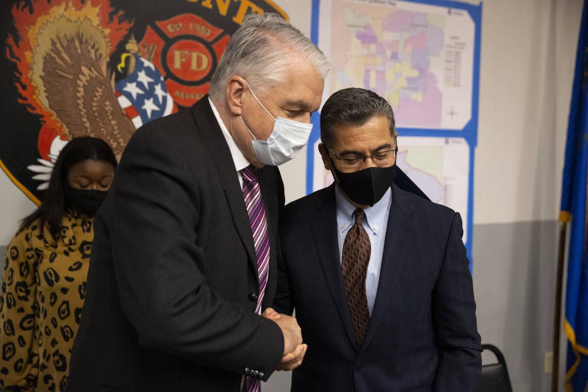 Nevada Governor Steve Sisolak, left, and U.S. Health and Human Services Secretary Xavier Becerr ...