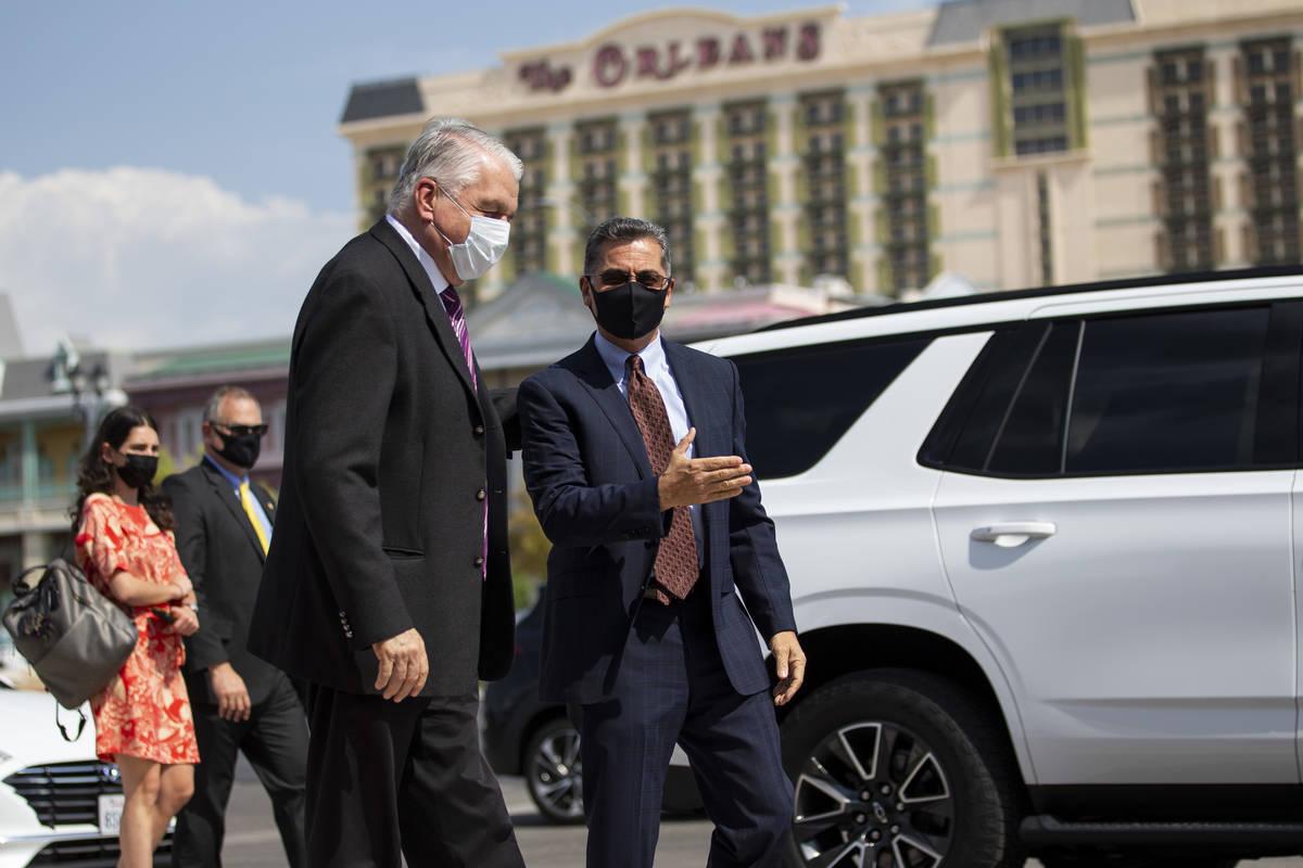 Nevada Governor Steve Sisolak, left, greets U.S. Health and Human Services Secretary Xavier Bec ...