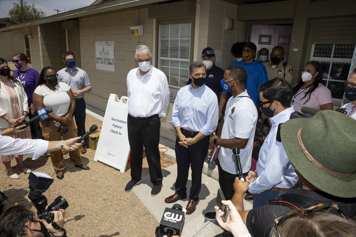 Nevada Governor Steve Sisolak, from left, Health and Human Services Secretary Xavier Becerra, C ...