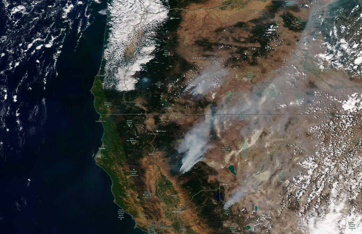 This satellite image provided by Satellite image ©2021 Maxar Technologies shows the wildfi ...