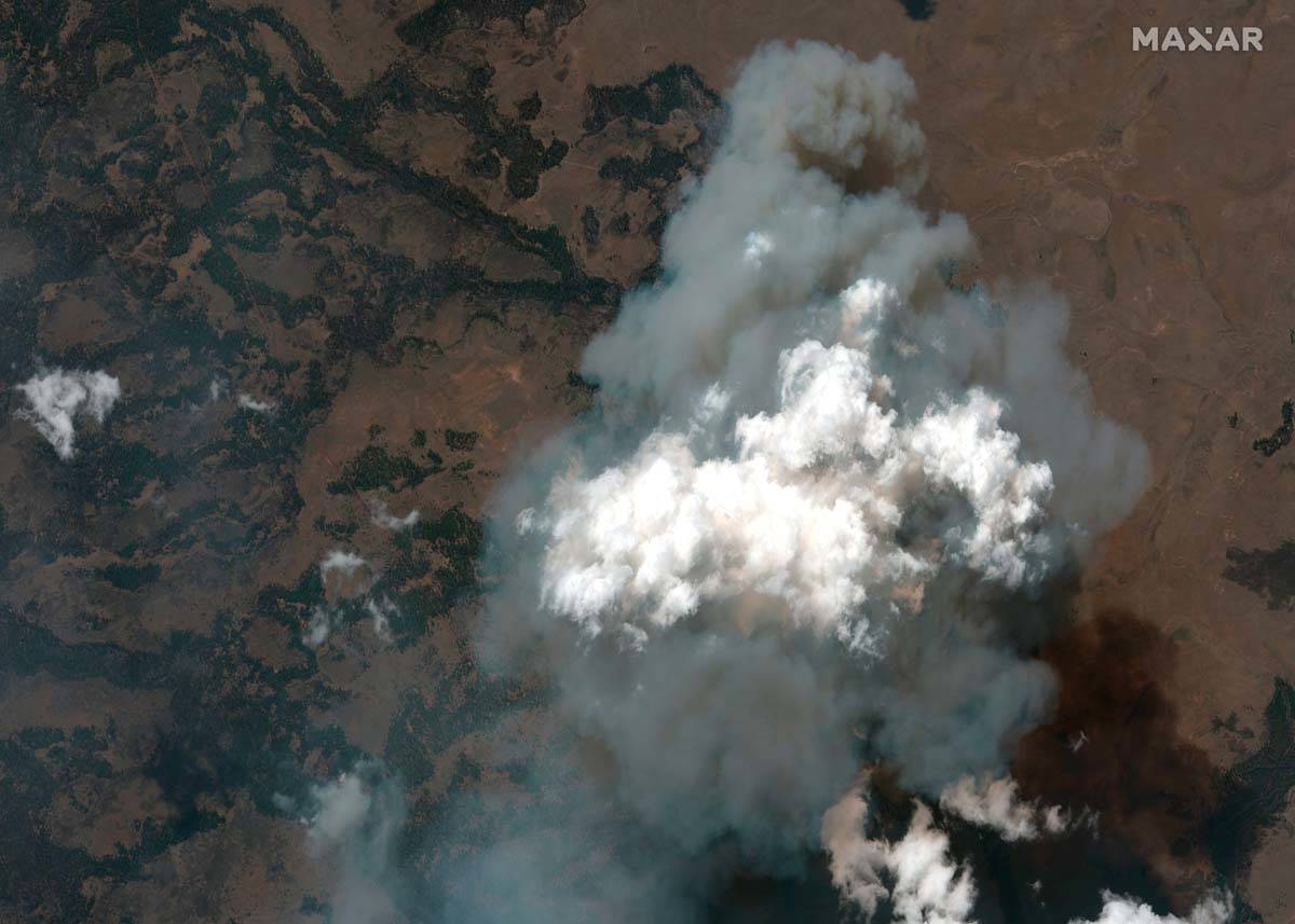 This satellite image provided by Satellite image ©2021 Maxar Technologies the Bootleg Fire ...