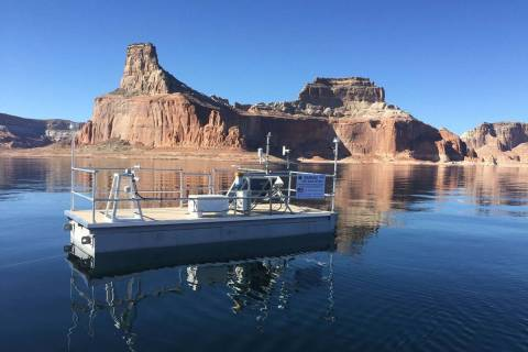 In this Nov. 7, 2018, file photo, a remote evaporation station floats in Lake Powell. (Desert R ...