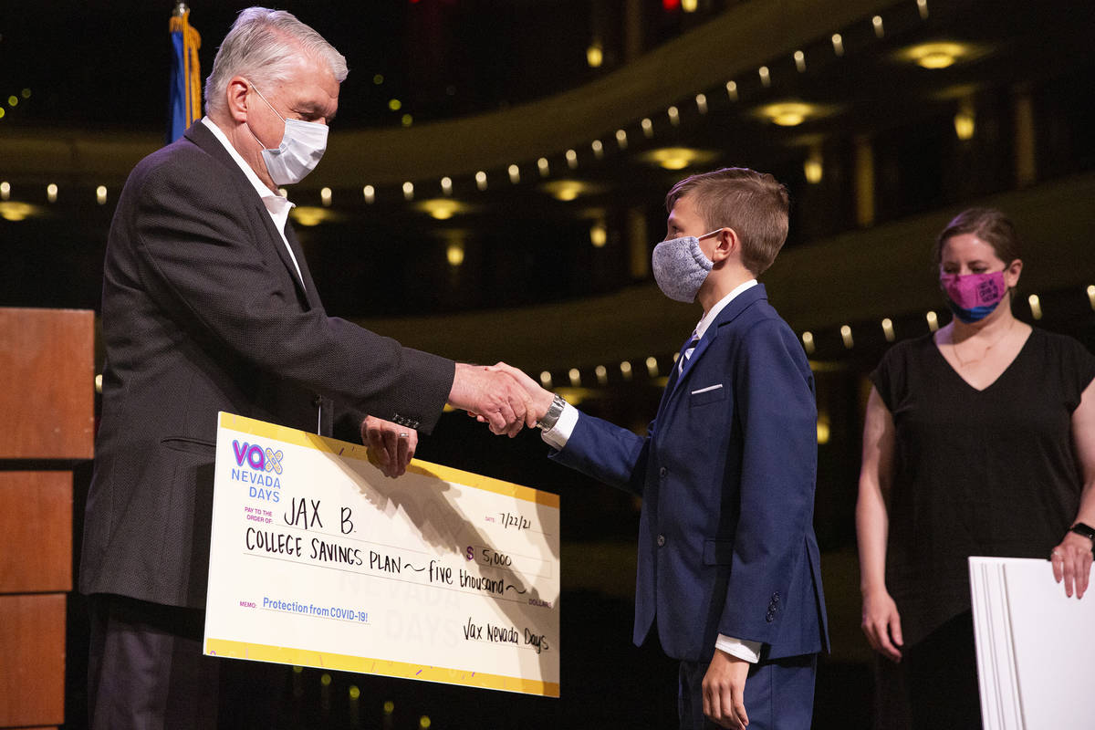 Gov. Steve Sisolak shakes Jax B.'s hand after he won a $5,000 college savings plan in the third ...