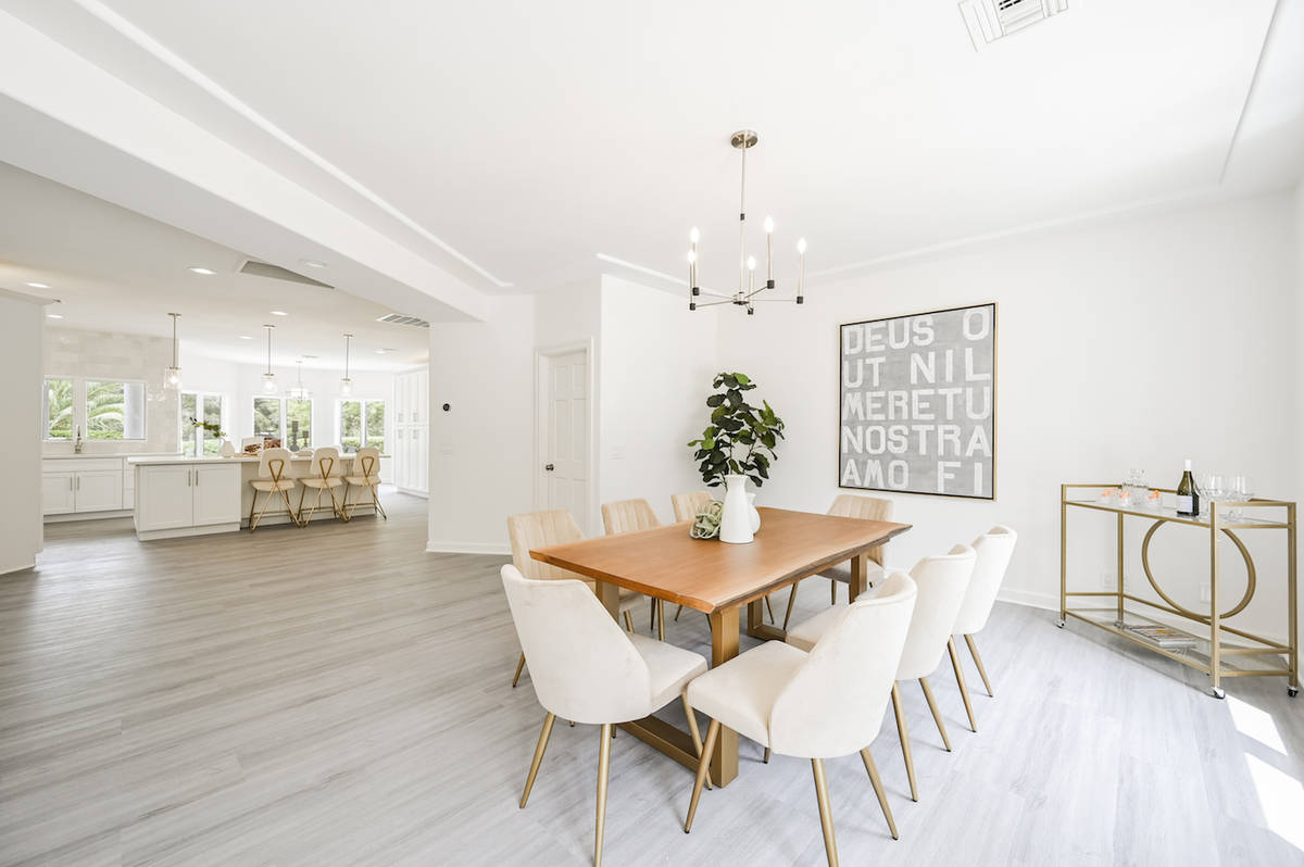The home features a formal dining area on the first level off the kitchen. (LUXE Estates & Life ...
