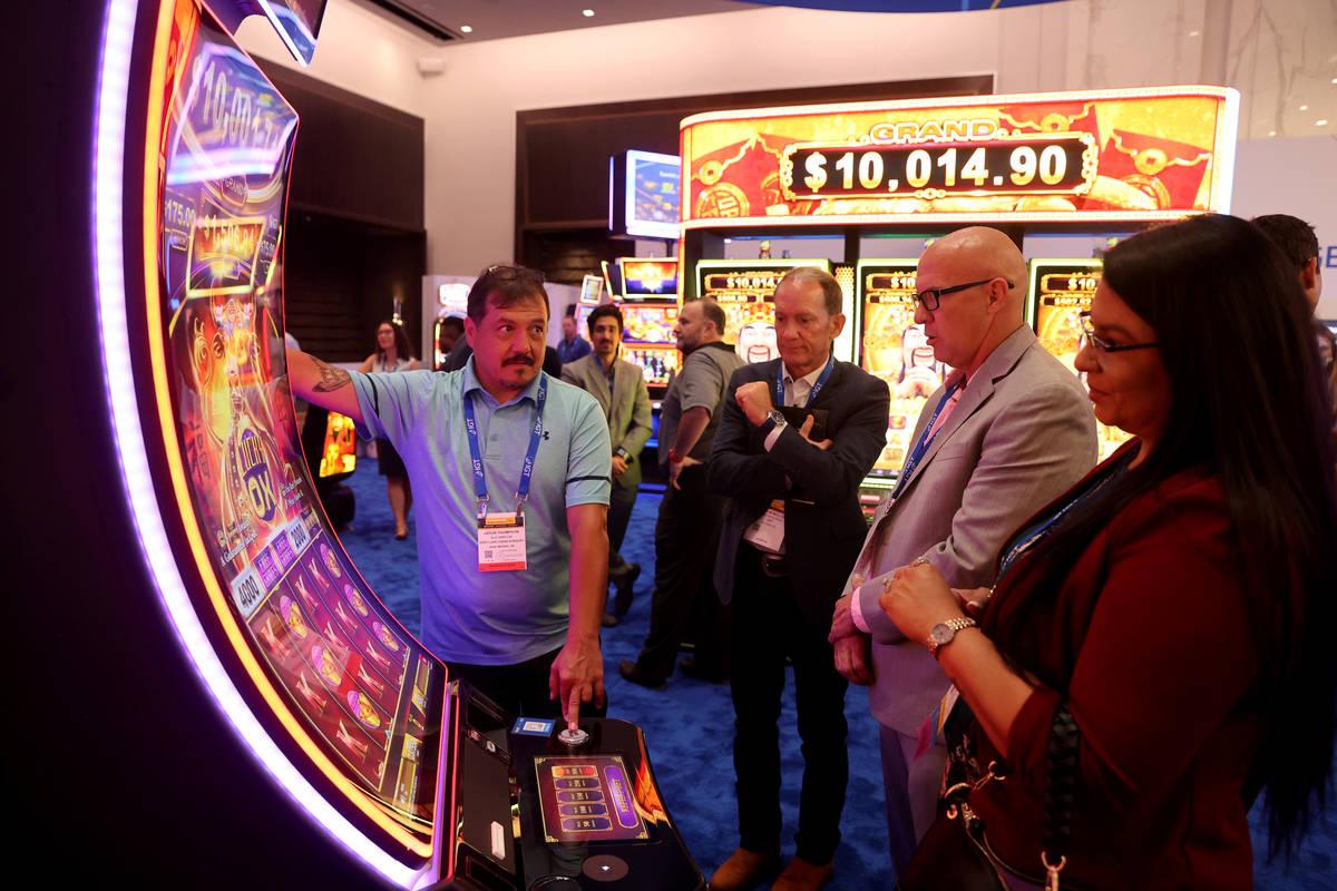 Jason Thompson, slot director at Spirit Lake Casino & Resort in Saint Michael, N.D., left, ...