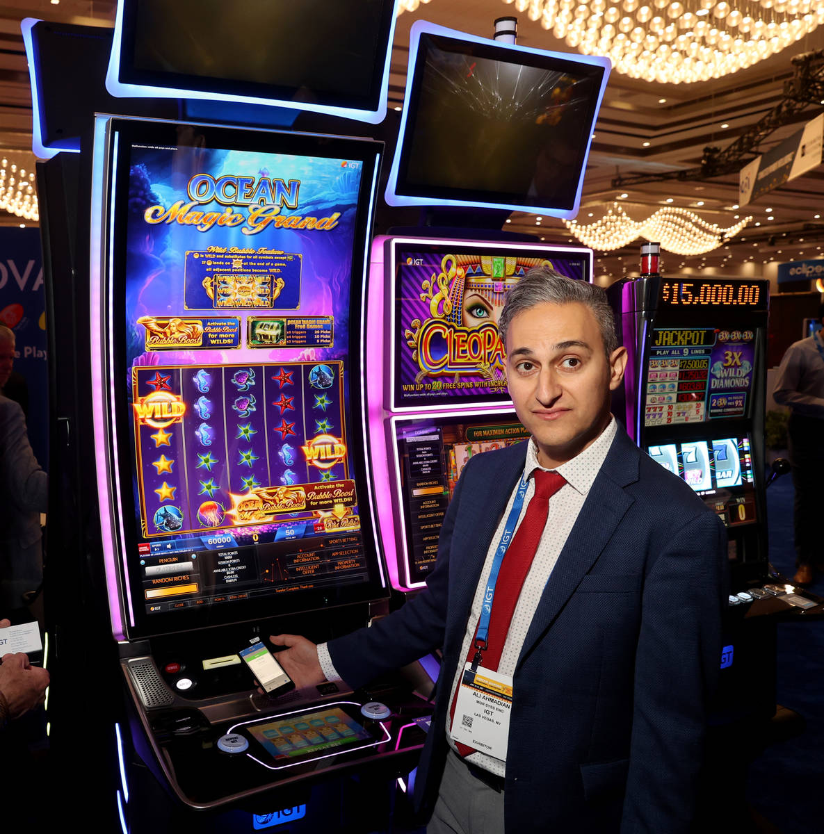 Ali Ahmadian, system engineering manager at IGT, shows cashless gaming at the IGT booth during ...