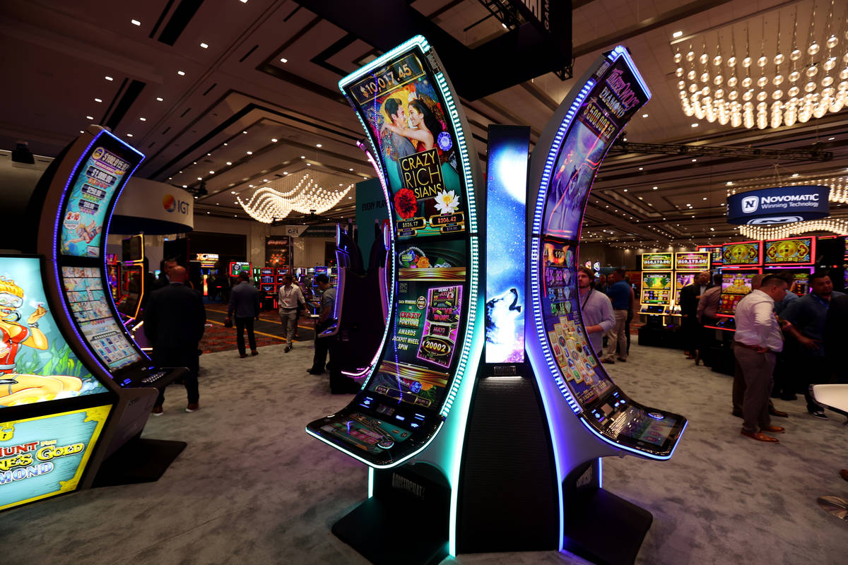 Aristocrat slot machines with the signature curved cabinet in the Aristocrat Gaming booth durin ...