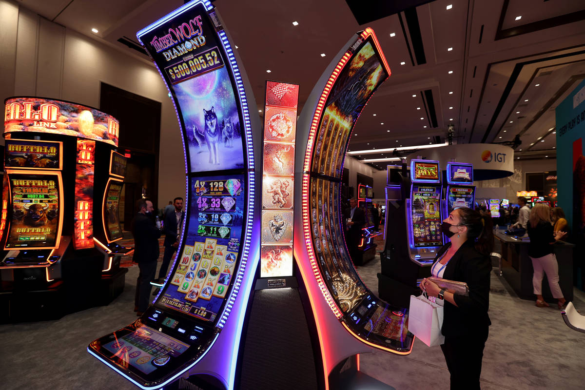 Wendy Merrill, assistant general manager at Grand Casino Mille Lacs in Onamia, Minn., plays the ...
