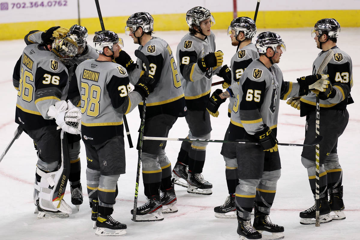 Henderson Silver Knights come together after a win against the Ontario Reign during an AHL hock ...
