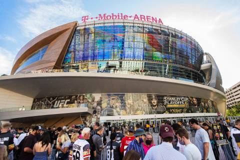 Fans wait to enter T-Mobile Arena before the start of Game 7 of an NHL Stanley Cup first-round ...
