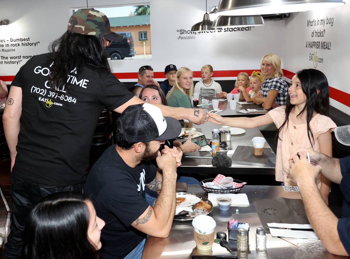 Criss Angel greets Maggie Zubia, 8, at his new restaurant, CABLP, in Overton during the grand o ...