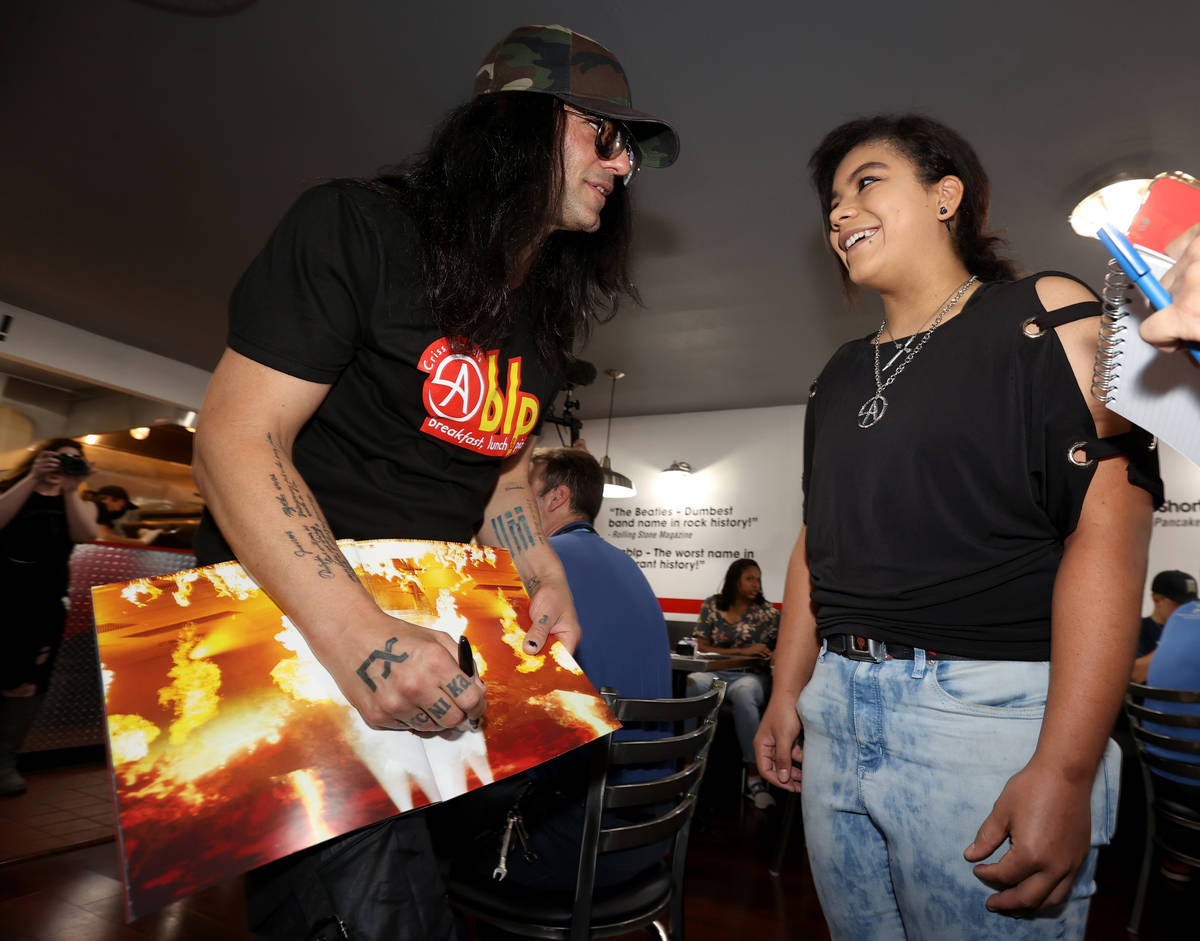 """Criss Angel signs an autograph for Patricia """"Z"""" Lucas at his new restaurant, CABLP, in Overton ..."""