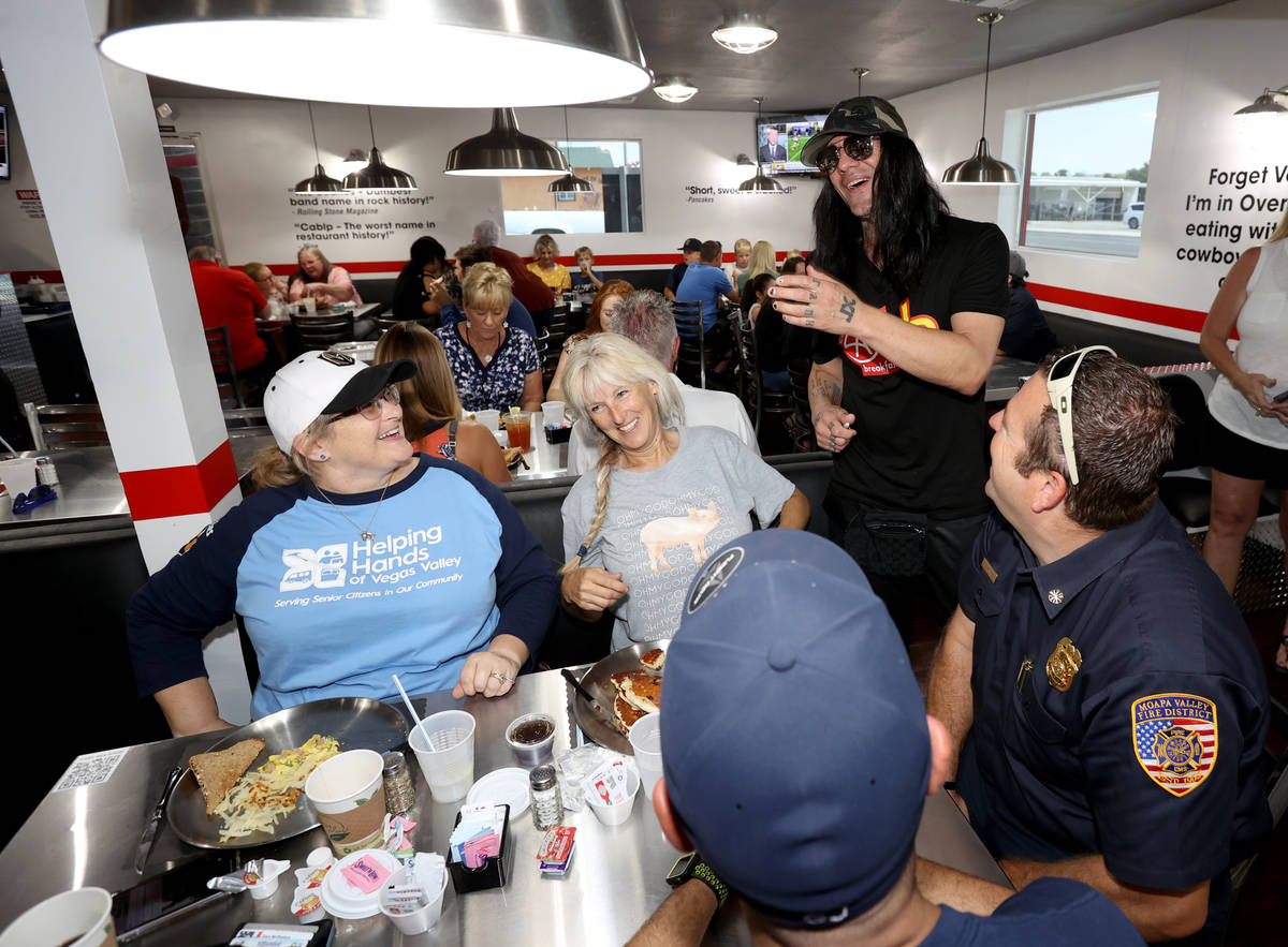 Criss Angel greets, from left, Shanna McPheters, Janice Ridondo, firefighter Greg Johnson and M ...