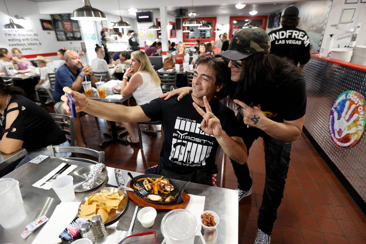 Criss Angel, right, poses with Sammy Vassilev at his new restaurant, CABLP, in Overton during t ...