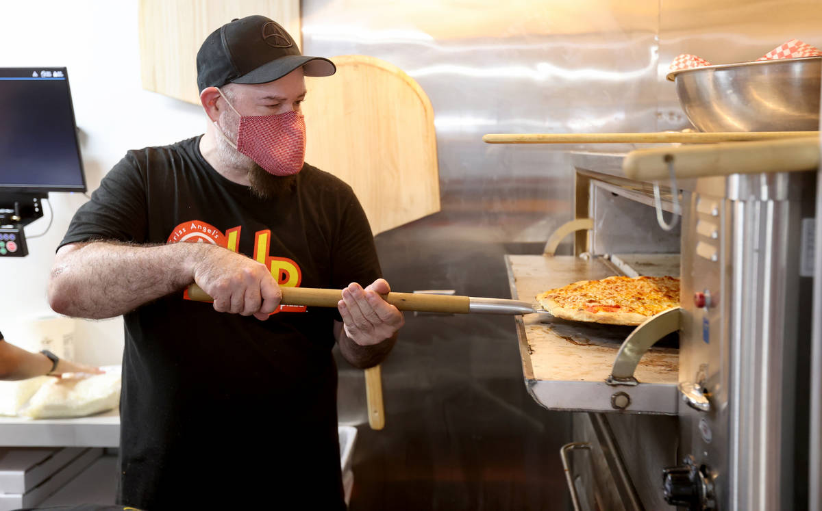 Criss Angel partner Michael Baram makes pizza at their new restaurant, CABLP, in Overton during ...