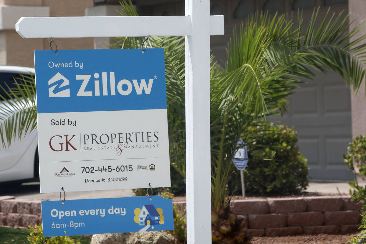 A sale sign is seen in front of a Zillow-owned house at 5296 Tartan Hill Ave. in Las Vegas, Fri ...