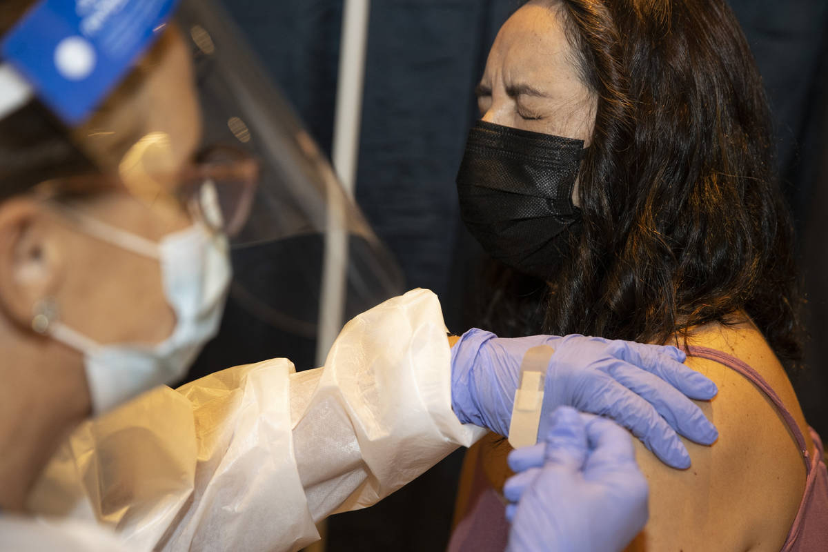 Jenny Richter of Las Vegas is vaccinated by registered nurse Janice Williams during the #VivaVa ...
