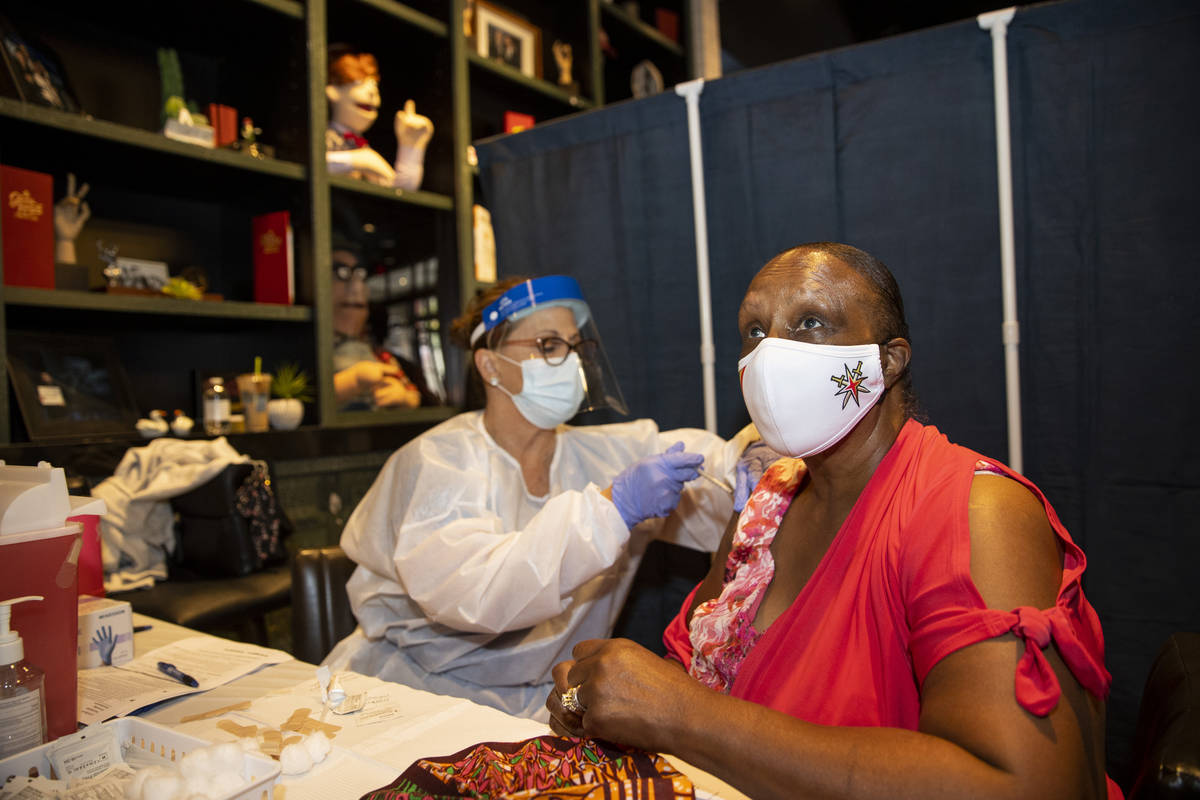 Toni Morrison of Las Vegas is vaccinated by registered nurse Janice Williams during the #VivaVa ...