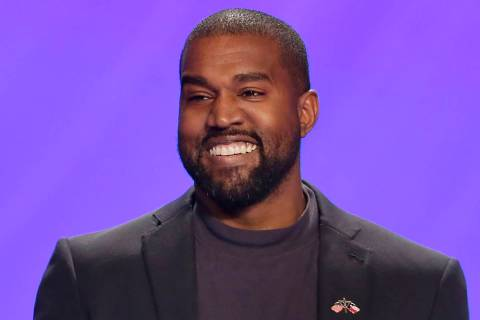 FILE - In this Nov. 17, 2019, file photo, Kanye West appears on stage during a service at Lakew ...