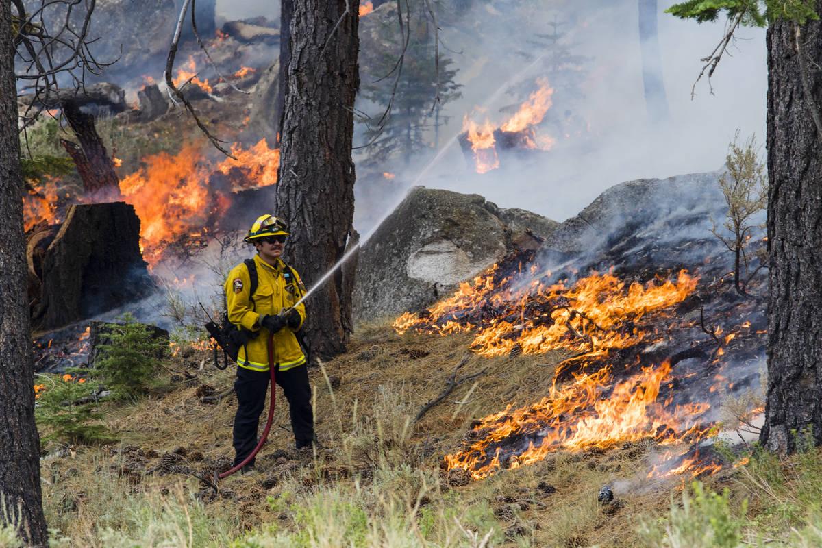 A So-Cal fireman battles the Tamarack Fire astir   California State Route 88 adjacent   Alpine Village ...