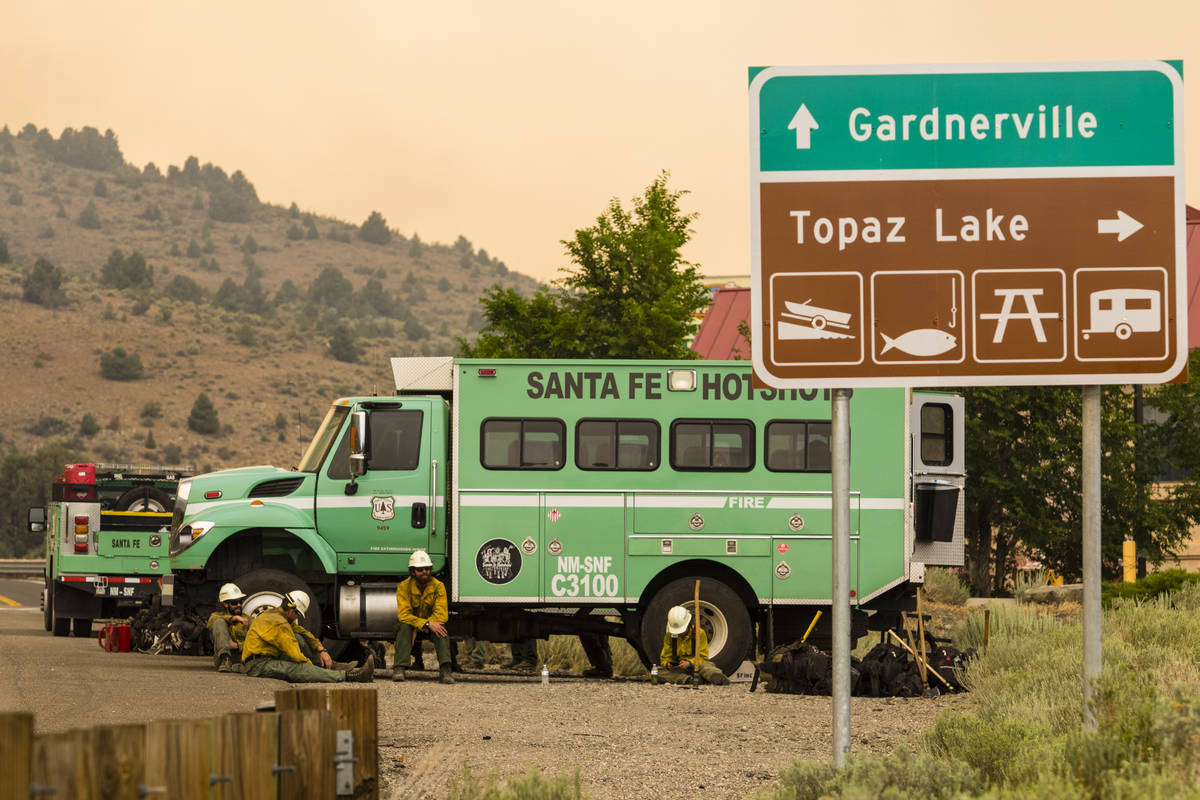 A Santa Fe Hotshots unit  is seen successful  Topaz Lake, Nev., Friday, July 23, 2021, portion    battling the ...