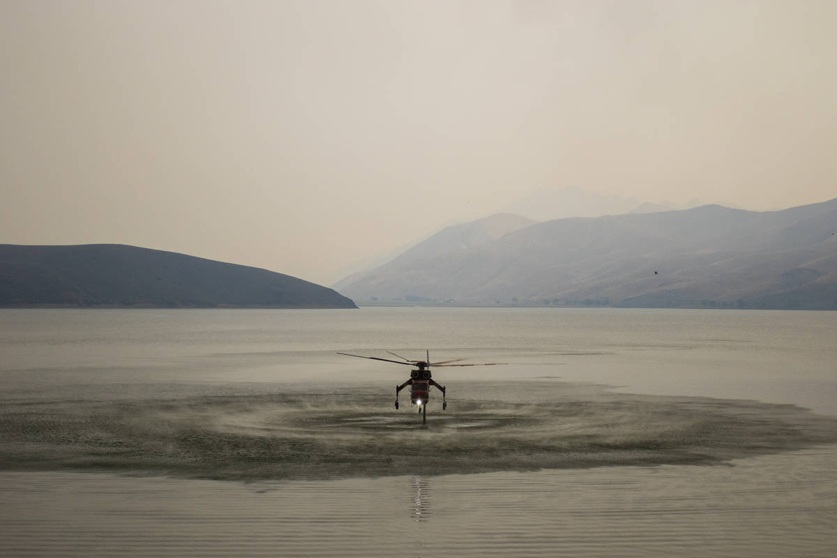 A firefighting chopper  is seen astatine  Topaz Lake, successful  Nevada, Friday, July 23, 2021, portion    the T ...