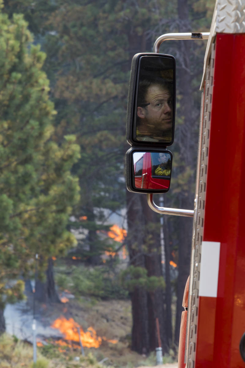 A So-Cal fireman is reflected successful  a broadside  reflector  astir   California State Route 88 adjacent   Alpine Vil ...