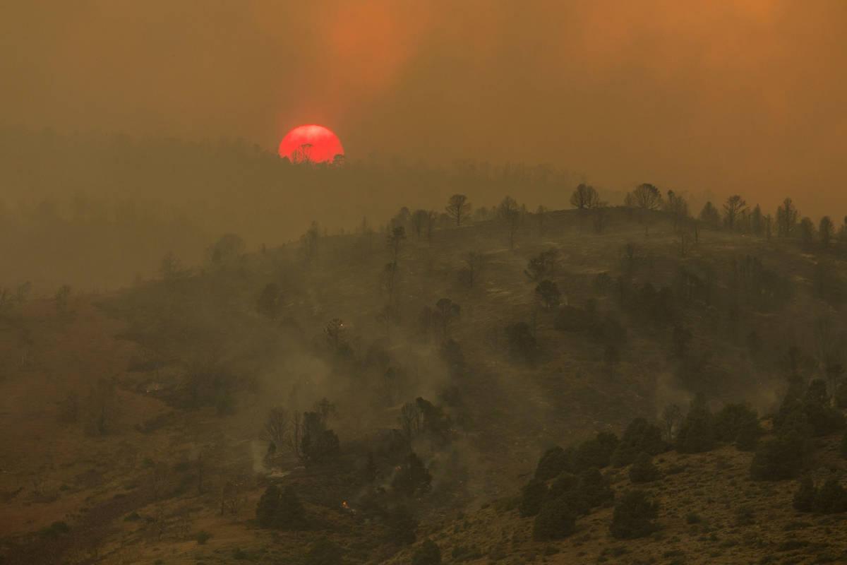 Sunset is seen arsenic  the Tamarack Fire burns astir   Topaz Lake, Nev., Friday, July 23, 2021.(Ty On ...
