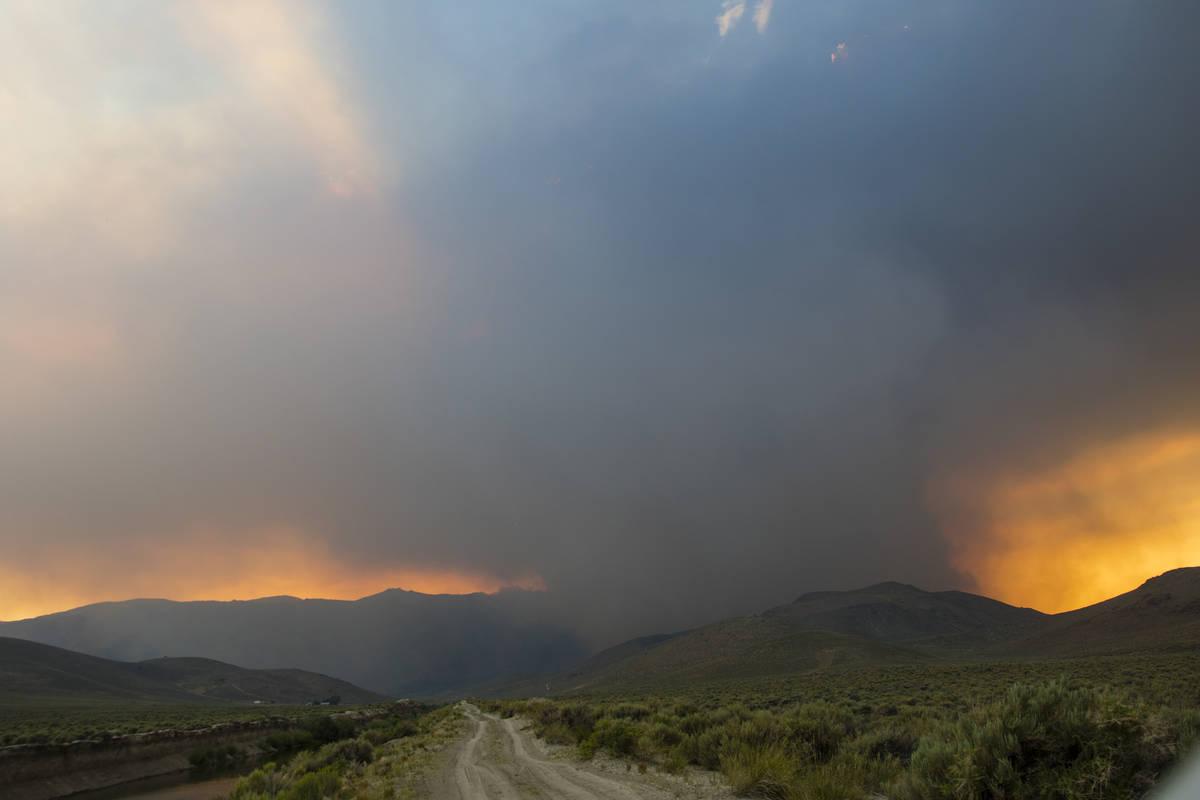 The Tamarack Fire burns adjacent   Nevada State Route 208, eastbound  of Holbrook Junction successful  Nevada, Frida ...