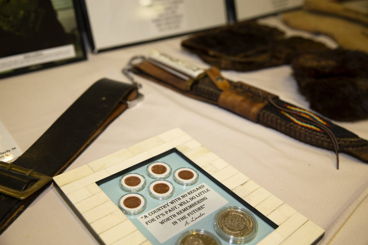 Antiques and memorabilia are displayed during an event for Buffalo Soldiers Day at Culinary Aca ...