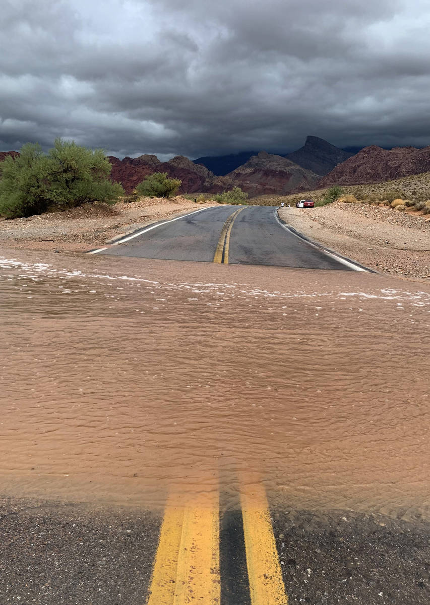 Floodwaters sweep across Calico Basin Road near Red Rock Canyon National Conservation Area on M ...