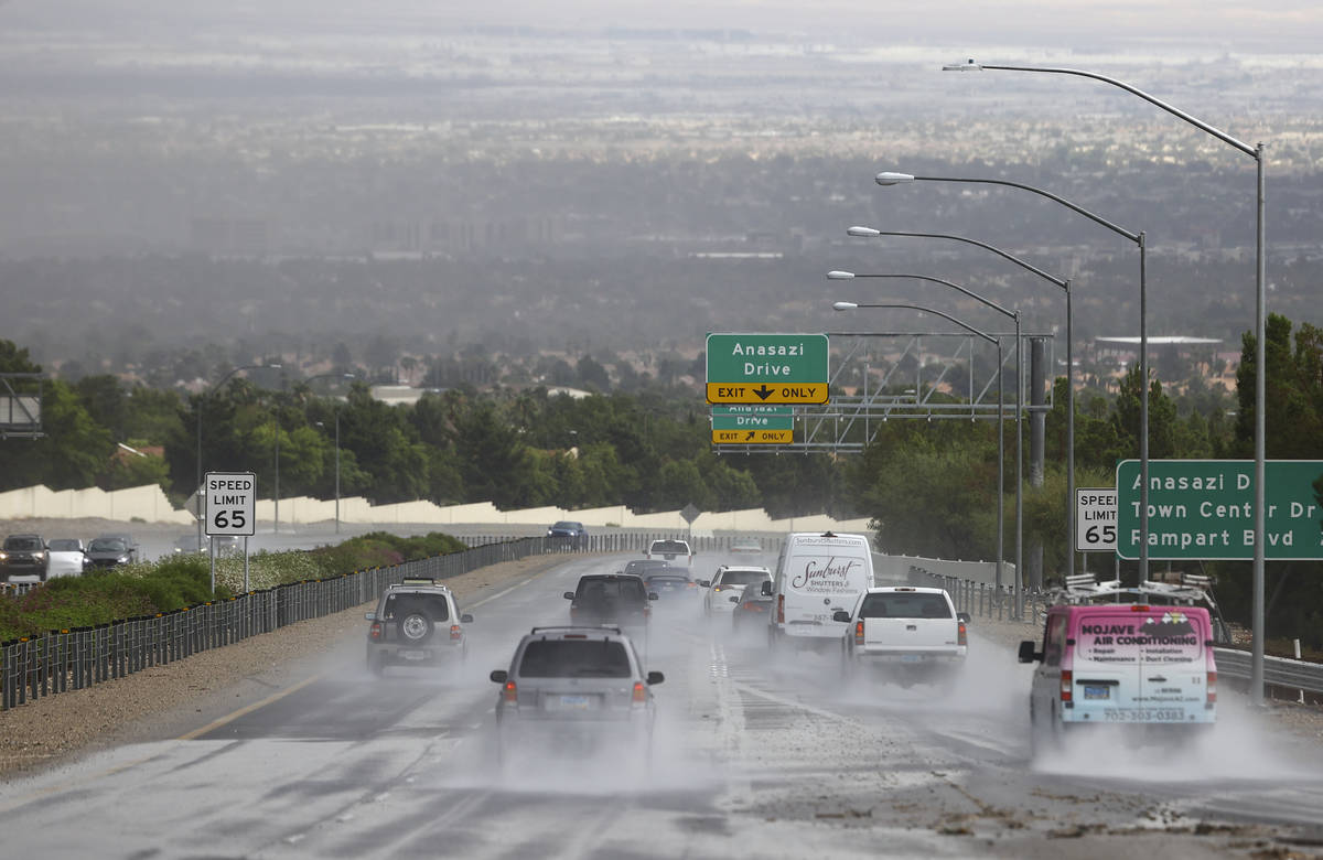 Vehicles travel on Summerlin Parkway as rain comes down over the Las Vegas Valley on Monday, Ju ...